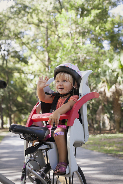 Young Girl Sitting In Childs Bicycle Seat, Enjoying -3135